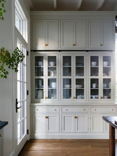 floor to ceiling gray kitchen cabinets