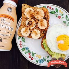 A sweet and savory breakfast with two slices of flax toast. One with sunnyside egg + avo; the other with Justin's peanut butter + sliced banana + Purely Elizabeth granola. Sided with my first Califia Farms iced coffee with almondmilk. - @cleanfood_cleanmind