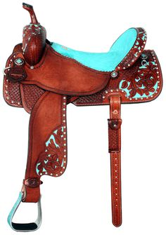 Love the turquoise accents on this dark leather saddle by Double J Saddlery. Wow!