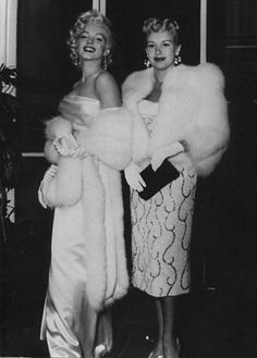Marilyn Monroe and Betty Grable arrive at the premiere of 'How to Marry a Millionaire', 1953.