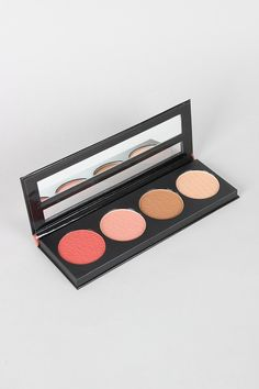 This beauty palette features two blush shades with complimentary bronze and highlighter shades.