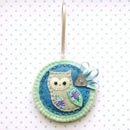 This is a beautiful hand stitched fabric owl Christmas decoration, in lovely icy blue shades . It features a little felt owl with applique wing and belly in pretty cotton print fabric. It is mounted onto a light blue felt base which is edged with silve...