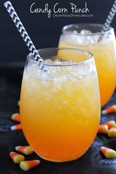 Layered drinks can be so fun for parties, and this Candy Corn Punch is perfect for Halloween! | DessertNowDinnerLater.com #Halloween #drinks