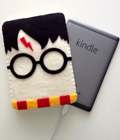 Felt, thread, and nontoxic glue - Pretty easy to make for my kindle
