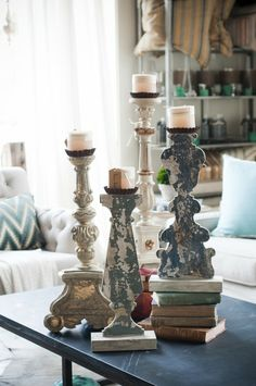 Candlesticks..want it higher, place it on some old books, looks nice