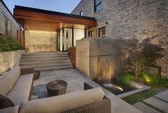 Darris Harris   Outdoor area with elegant waterfall, eating area, and spacious sitting room
