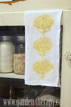 Fabric stamping- block printed tea towels. Cute idea!