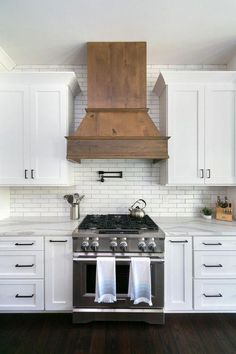 White and Wood Modern Farmhouse Kitchen with White Cabinets and Wood Range Hood . - White and Wood Modern Farmhouse Kitchen with White Cabinets and Wood Range Hood - Farmhouse Kitchen Cabinets, Modern Farmhouse Kitchens, Home Kitchens, Farmhouse Decor, Kitchen Modern, Farmhouse Ideas, Farmhouse Style, White Farmhouse, Farmhouse Interior