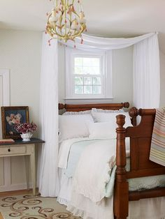 Frame a headboard with a canopy to draw the eye up to the ceiling. A simple swag of fabric loosely draped over two swing-arm curtain rods positioned just below the ceiling gives this cozy cottage room a romantic and elegant finish. (this site has neat ideas for small bedrooms)