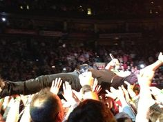 Bruce Springsteen crowd surfing in Boston concert.  Bruce is 62 in this photo.  Forever young, I want to be forever young.  Yeah, not a Bruce lyric but you get the idea.  I love The Boss.