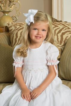 Smocked and embroidered princess heirloom dres by Strasburg Children! Great holiday gift any little girl is sure to love!