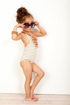 The diva pose is a bit much, but at least she isn't in some pedophiles dream of a bathing suit.     This is actually quite adorable for a little girl.