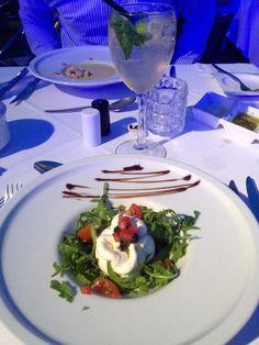 Mozzarella, rocket and tomato salad started at Yacht Club, Cala d'Or, Majorca.
