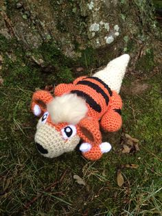 Pokemon Inspired: Growlithe Amigurumi Crochet by TheTallGrass Handmade plushie (in crochet Amigurumi style) of the dark type, Mightyena, from Pokemon!   Growlithe measures 9in long, 4in tall and 6in wide. He is stuffed with polyfil stuffing and his eyes/nose/inner ears are needle-felted on while his head tuft, and neck ruff are fluffed out yarn for a very soft fur-like feel.  Growlithe takes about 4-5 days to complete, so please allow at least 2-3 weeks for completion (I do get quite busy)