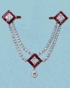 Henri Picq for Cartier Paris - A magnificent Art Deco brooch-pendant, circa 1922. Set in platinum and 18ct gold with calibré cut Burma rubies and old brilliant cut diamonds.