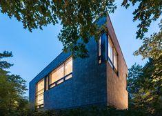 House in Canada with a concrete brick facade by Kariouk Associates.