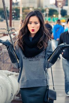 long gloves over gray sweater long sweatshirt over leather dress or skirt CUTE