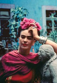 dodgenburn:  Nickolas Muray(1892-1965, American, b. Hungary) -Frida leaning on a sculpture by Mardonio Magaña, Coyoacán, Mexico, 1940