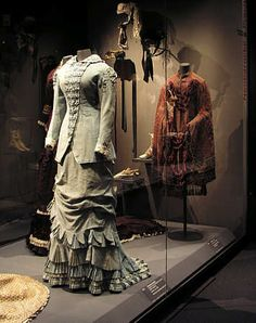 "Walking dress, German, 1880. ""Telescope dress"" with cascading ruffles on the skirt and a tight-fitting jacket."
