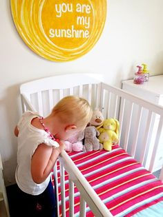 7 budget friendly tips for decorating kids spaces.  Love the reading corner with beanbag chair and spray painted framed photos and baskets at kid level!