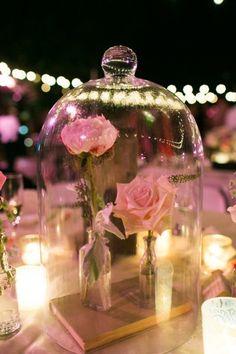 Cute for a birthday party or even as a little touch for the fan of the story at her wedding - Beauty and the Beast Magic Rose centerpieces.