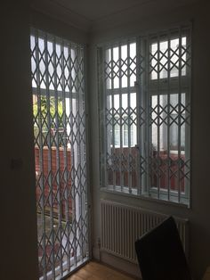 RSG1000 retractable security grilles fitted to the door and window of a domestic premises in North London.