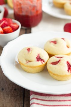 A grab and go pancake cup made in a muffin tin and stuffed with fresh strawberries