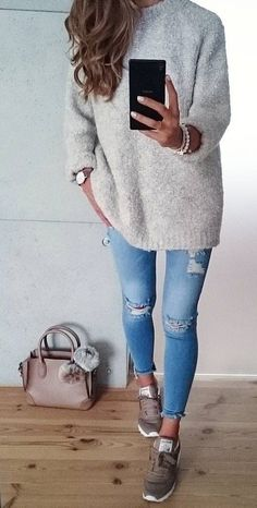 casual cute look in sneakers, ripped jeans, grey sweater