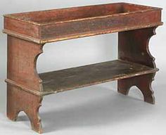 """A Lancaster County, Pennsylvania, 31"""" high x 48"""" wide painted poplar dry sink/water bench, mid 18th century, with an Ephrata Cloister provenance"""