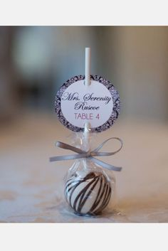 place cards with party favor pop.