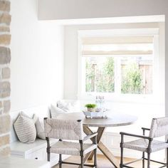 BECKI OWENS- 7 Elements of the Modern Farmhouse. White kitchen nook with warm rustic wood and stone.