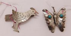 """439: 2 Mexican Sterling Silver Pins, circa 1950s. Made of sterling silver and turquoise, the items measure 1 3/16"""" to 1 5/8"""" long. Mexico, Taxco. Bird pin is signed FVB, butterfly is signed FM. 5.4 grams total. Butterfly pin has 2 pieces of turquoise and silver beading. Condition: Good, some wear, see images. Shipping: $12.50 w/insurance and signature."""