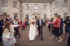 Bride and groom have confetti showered down on them outside Smedmore House wedding venue in Dorset Marquee Wedding, Wedding Ceremony, Country House Wedding Venues, Burgundy Bridesmaid Dresses, Documentary Wedding Photography, Wedding Confetti, Wedding Suits, Newlyweds, Wedding Photos