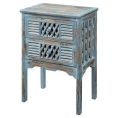 """Two-drawer fir wood accent table with lattice-front drawer and louvered insets.  Product: Accent tableConstruction Material: Fir wood and MDFColor: Bali blueFeatures:  Two drawersLattice-style panels Dimensions: 27.5"""" H x 18.5"""" W x 13.25"""" D"""