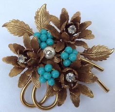 Miriam Haskell floral brooch, gold tone metal, faux pearl, rhinestones, and turquoise glass beads (eBay)