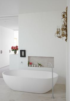I'm so drawn to the simplicity and romanticism of this bathroom...