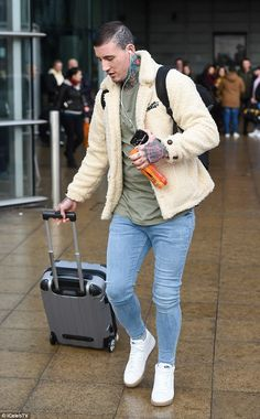 Keeping it casual:The ex of Hollyoaks actress Stephanie Davis wrapped up for the outing i...
