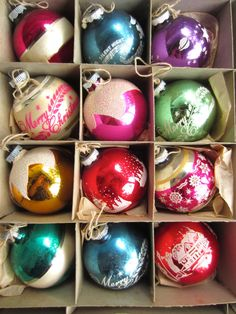 Vintage box of Shiny Brite Christmas Tree Ornaments. 12 glass balls in their original Shiny Brite box with Uncle Sam and Santa shaking hands. These are all 3 decorated bulbs. All have metal caps with Shiny Brite Made in USA. They each have string tied to the caps for hanging. Ornament description (left to right with image #2) 1. Red ball with white band around the middle that has silver on the borders of the band 2. Blue ball with Silent Night Holy Night musical notes and angels 3. Purple…