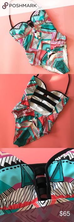 NWOT La Blanca Geo Strappy One Piece Swimsuit La Blanca multicolored geo Print strappy one piece swimsuit. Teal, coral, purple, black, and white colors.  • New without tags, still has the hygiene strip! • removable cups • please see last photo for fit guide La Blanca Swim One Pieces