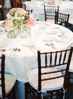 Elegant Pink and White Wedding Centerpieces   Use the pink carnations and then the spray roses?
