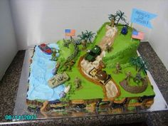 "Army Cake - This is a 11x15 sheet cake w/ 6"" on top. All BC icing w/ toy army men and vehicles."