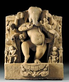 A Sandstone Figure of a Dancing Ganesha   India, Madhya Pradesh, 10th/11th Century   The potbellied deity carved in openwork dancing on a lotus pod, reaching out to a bowl of sweets with his trunk and flanked by musicians, his face with a humorous expression  39½ in. (100.3 cm.) high -- I haven't seen one like this before.