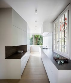 minimalist kitchen in this Paris Home by 05 AM arquitectura | Photo by Adria Goula Sarda