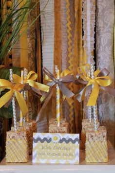 Sweet Simplicity Bakery: You Are My Sunshine Themed Baby Shower in Yellow, White and Grey; Dessert, Chocolates and Candy Display Table Buffet; White Chocolate Rice Krispies Treats on Paper Straws