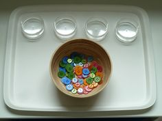 This practical life activity is also a preparation for mathematics. Sorting buttons is a good skill to differentiate colours and divide objects into sets. Montessori Activities, Activities For Kids, Crafts For Kids, Arts And Crafts, Art Crafts, Outdoor Activities, Sorting Colors, Practical Life, Tot School