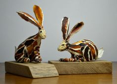 A pair of Hares, papersculpture by Suzanne Breakwell