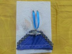 Kohala Peles Playground Series bookmark necklace. Kohala is part of the Peles Playground Series of bookmark necklaces. It is made of blue aloha fabric. Blue, black and silver seedbeads cascade in a zigzag pattern down the sides depicting the valleys and waterfalls of this volcano. A