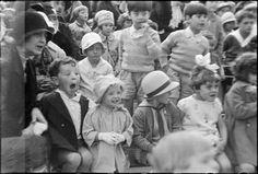 Paris 1928 photo by André Kertész (children watching an outdoor puppet show)