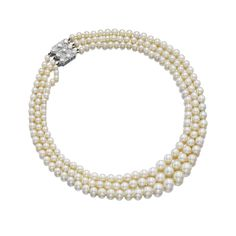 Very fine natural pearl and diamond necklace, Chaumet Designed as three rows of graduated natural pearls, the geometric clasp pavé-set with carré- and single-cut diamonds.