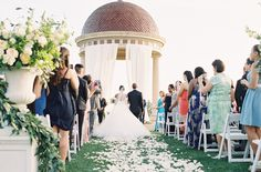 a film photograph of a father walking his daughter down the aisle in California